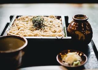 white pasta on black wooden plate