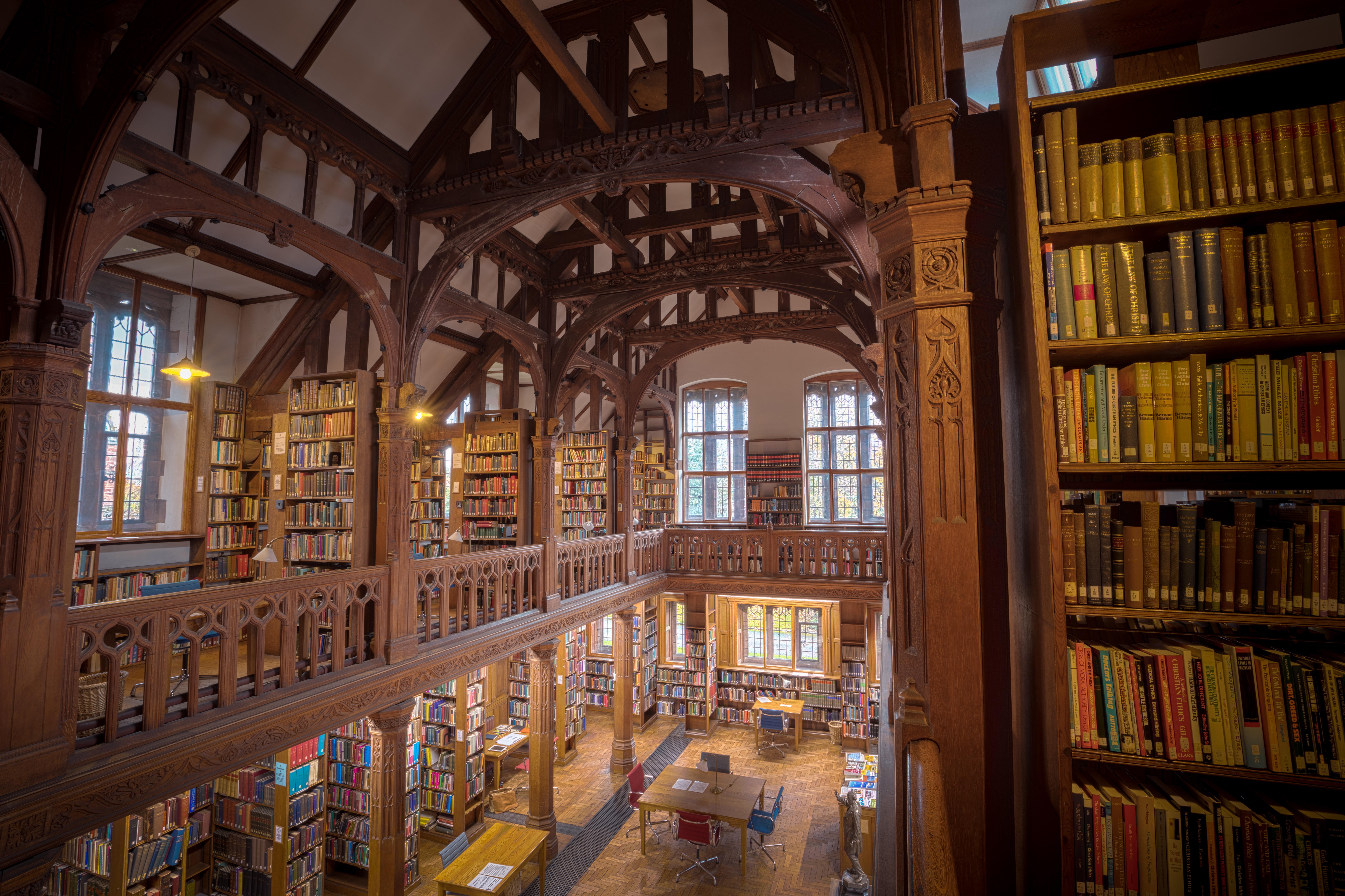 close-up photo of books arranged on shelf