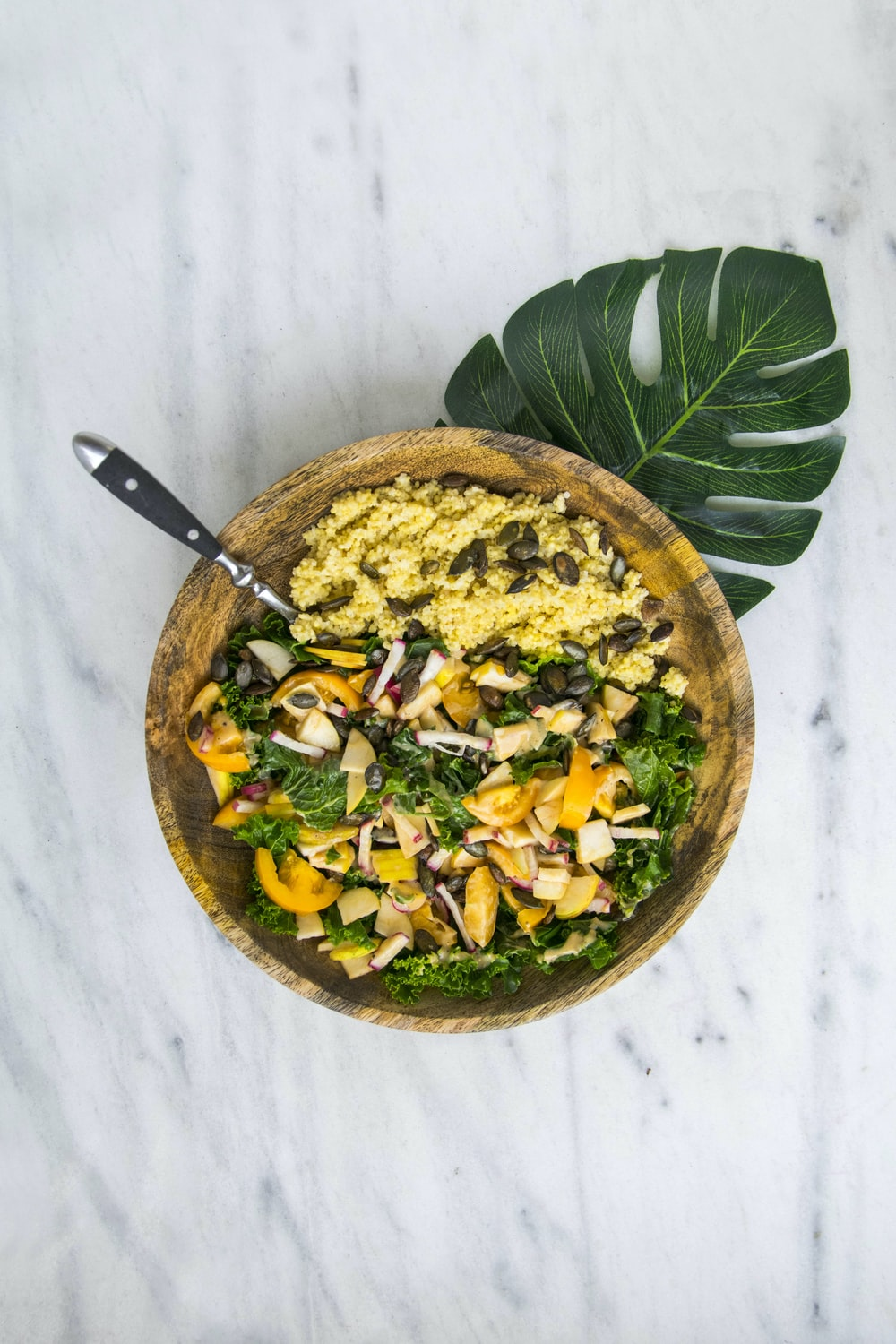 cooked rice with vegetable salad in brown wooden bowl