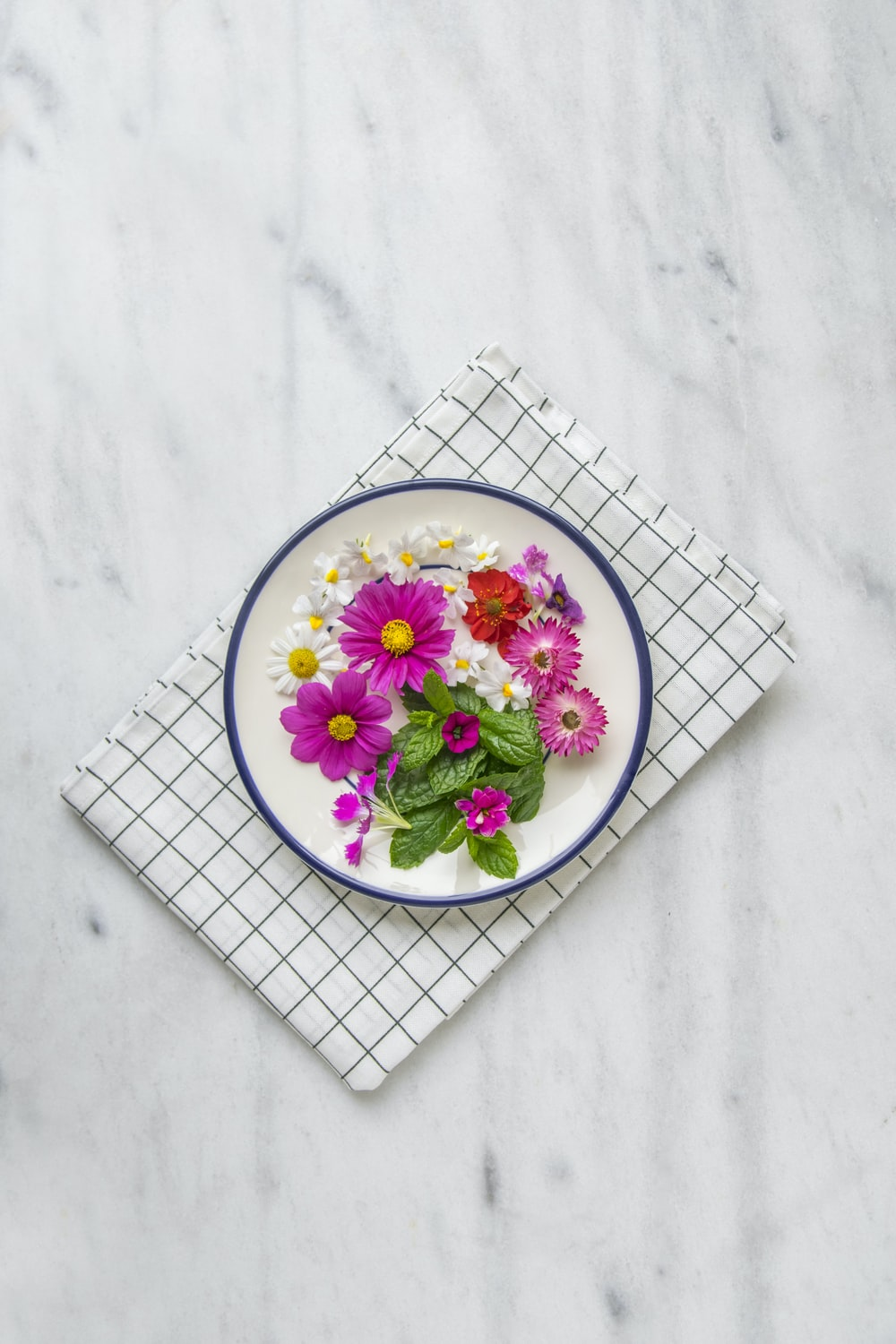 pink petaled flower on white plate