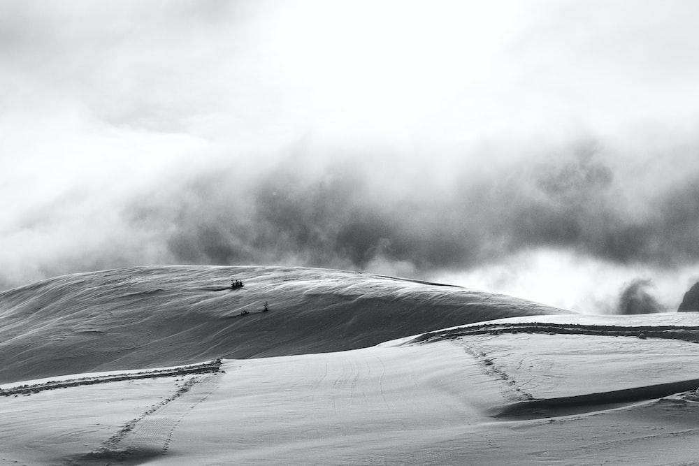 grayscale photo of sandstorm in desert