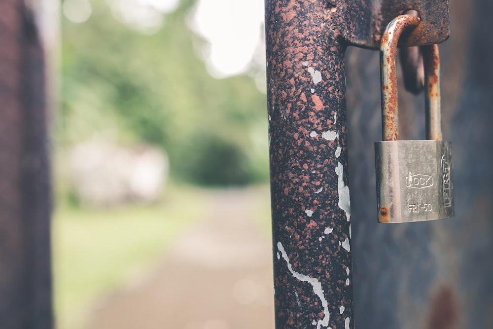 padlock on metal bar