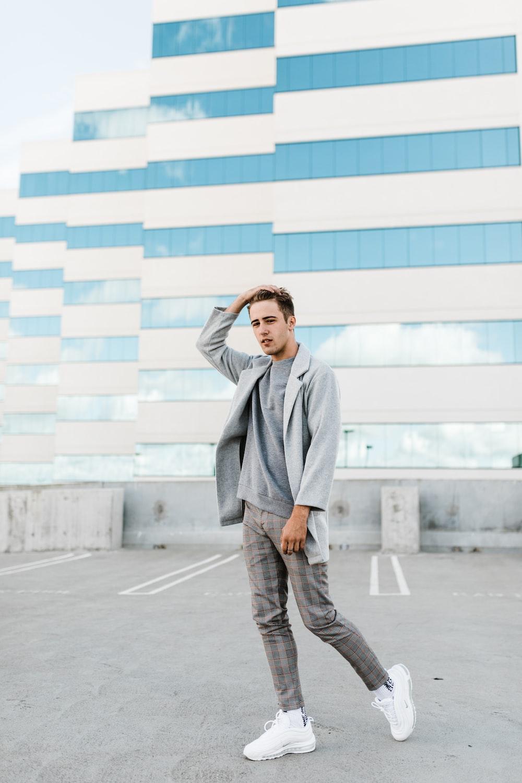 man wearing gray shirt, pants and coat