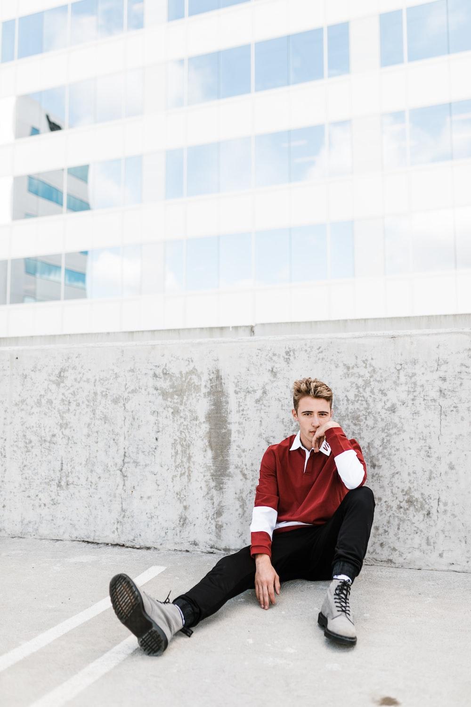 person sitting on white concrete flooring