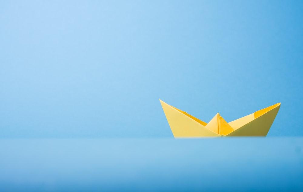 closeup photo of yellow paper boat