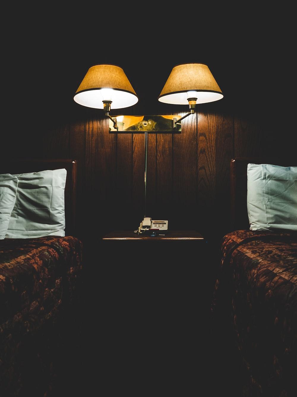 wall lamp in between of beds