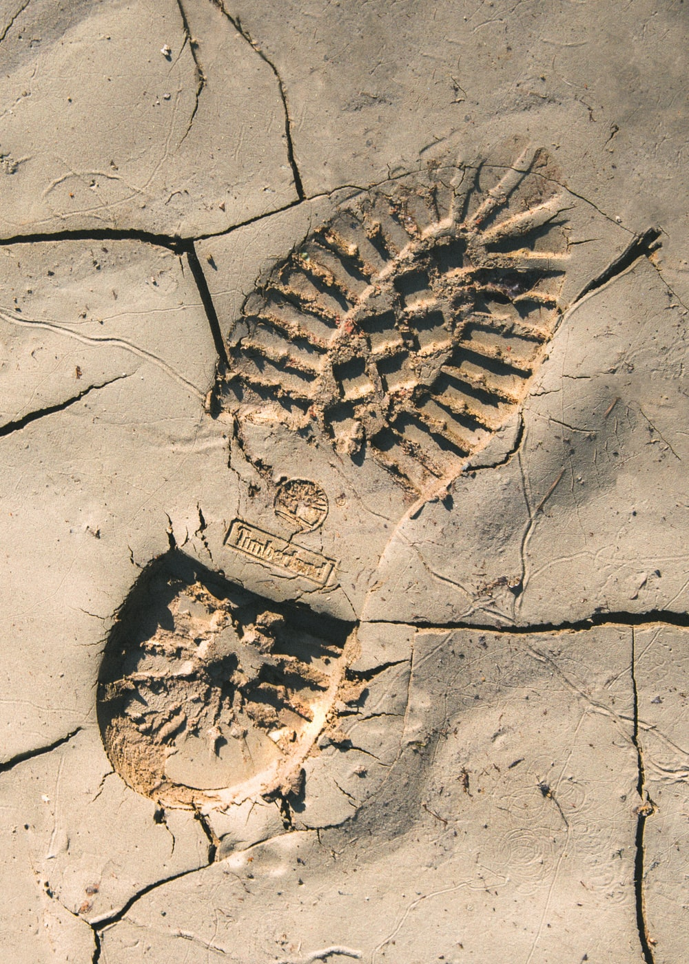 Timberland boot footprint on sand