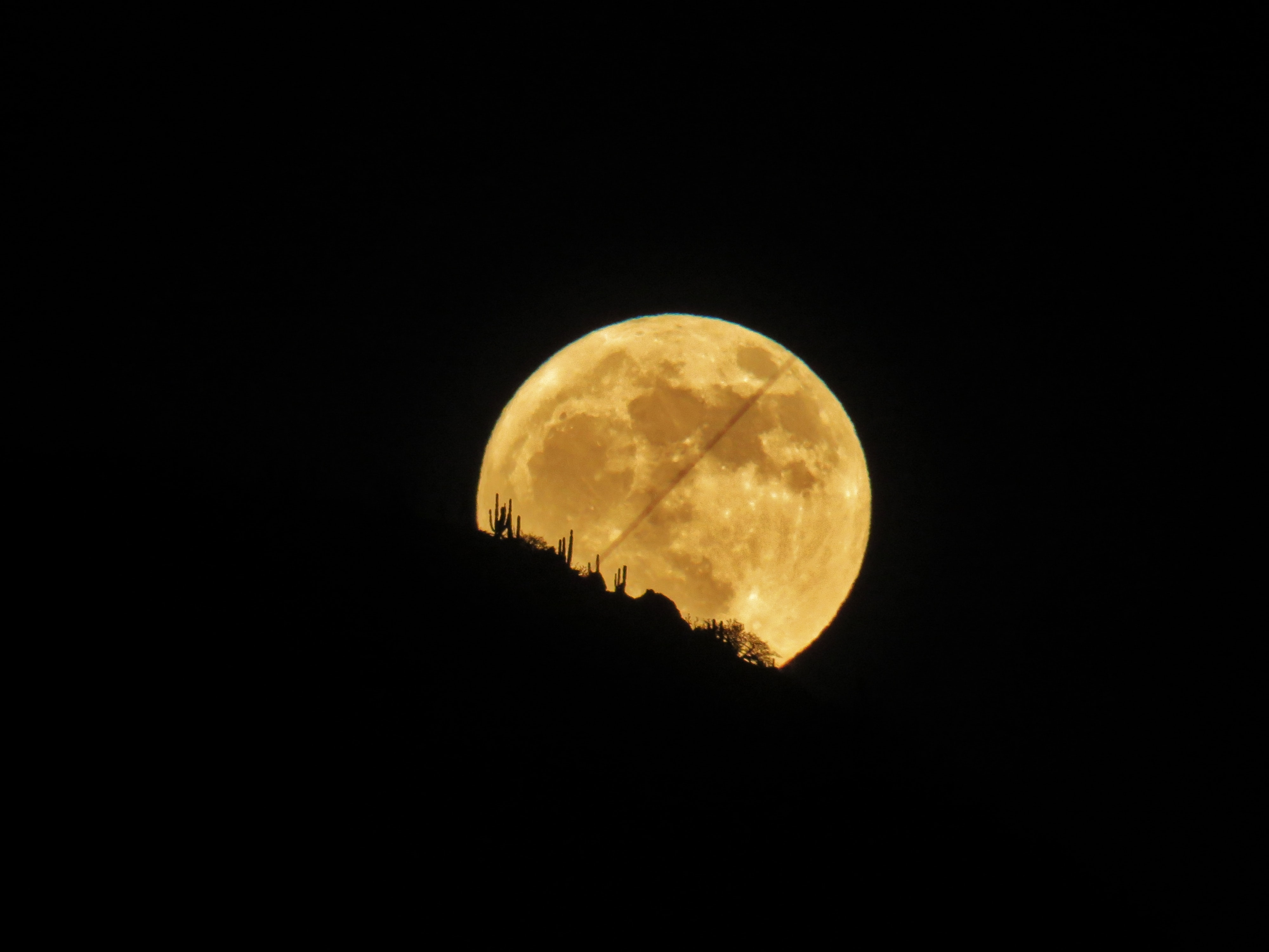 moon behind mountain