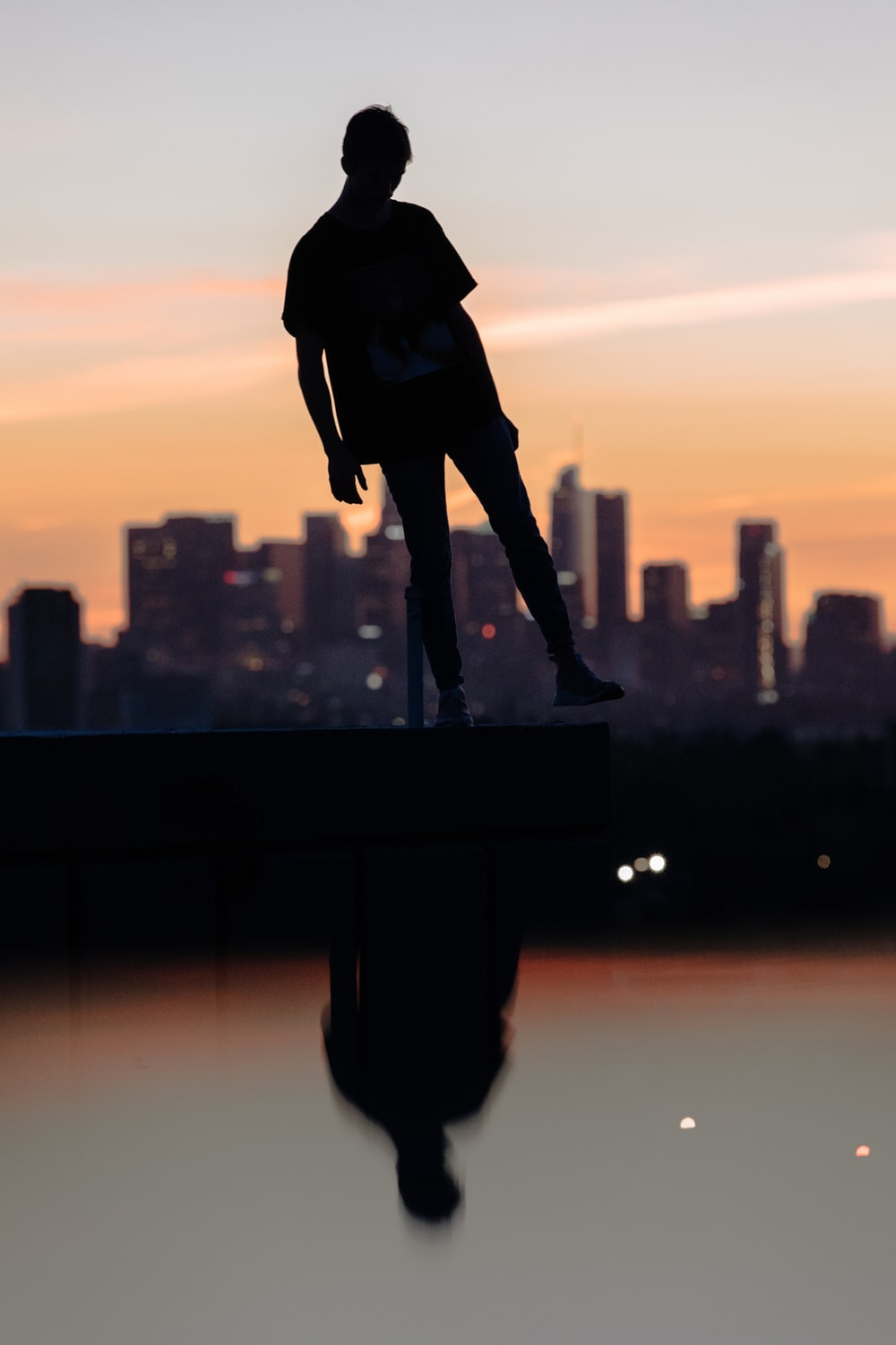 silhouette photograph of person lifting its foot
