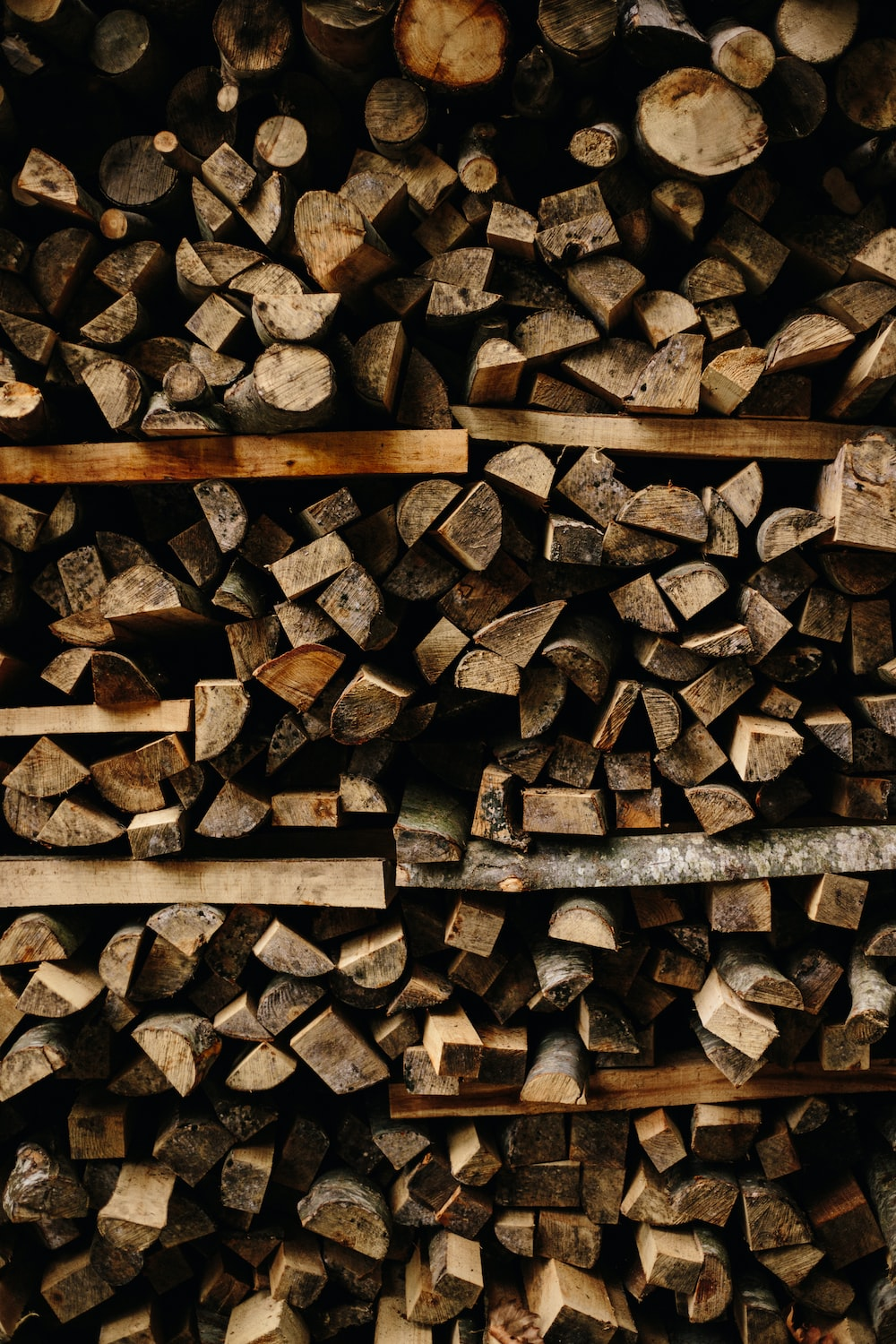 photo of brown wooden firelogs