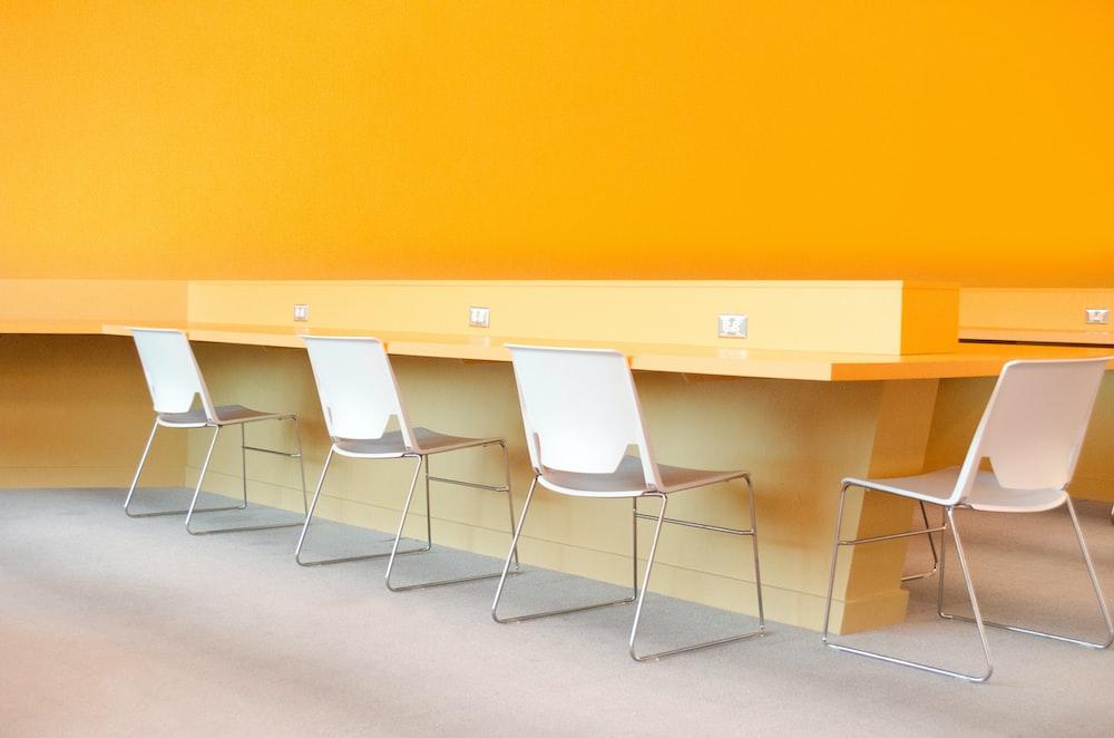 four chairs near desk