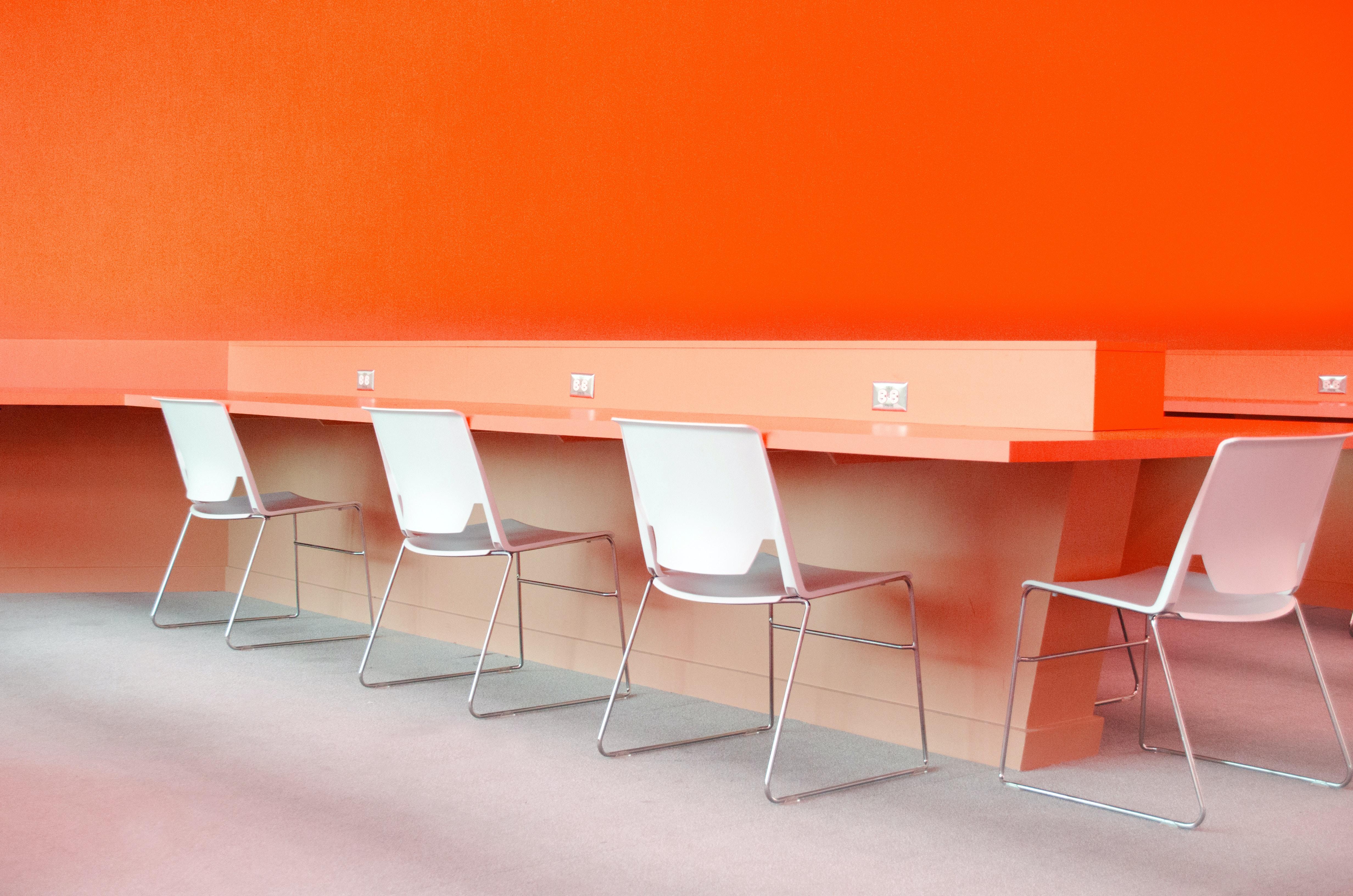 white plastic chairs under desk
