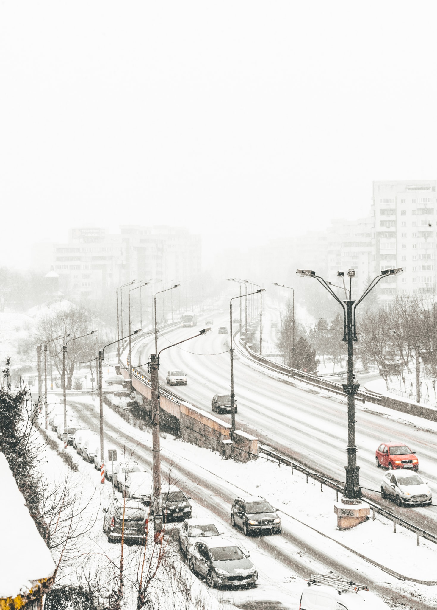 aerial view of road coated snow with vehicle passes
