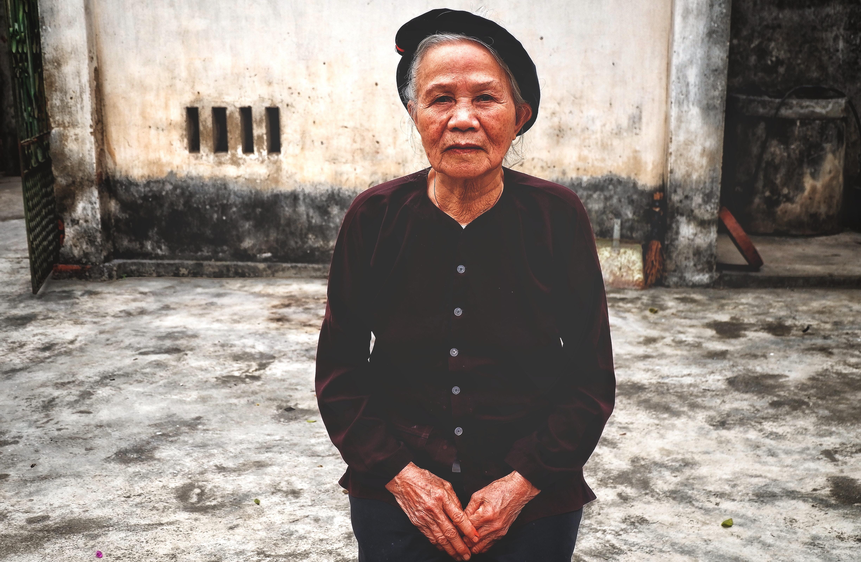standing woman wearing maroon velvet long-sleeved shirt