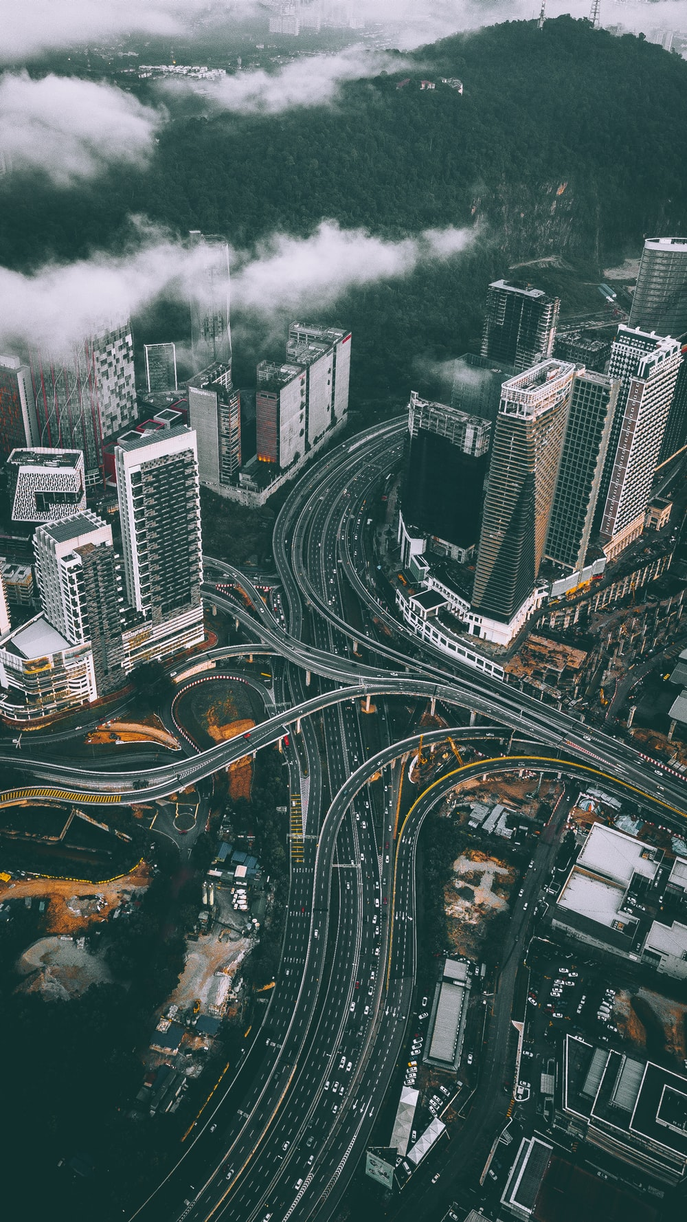 bird's eye view photography of high-rise buildings and bridges