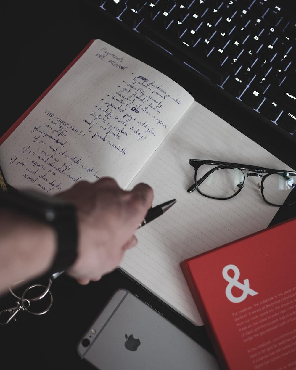 eyeglasses on white notebook