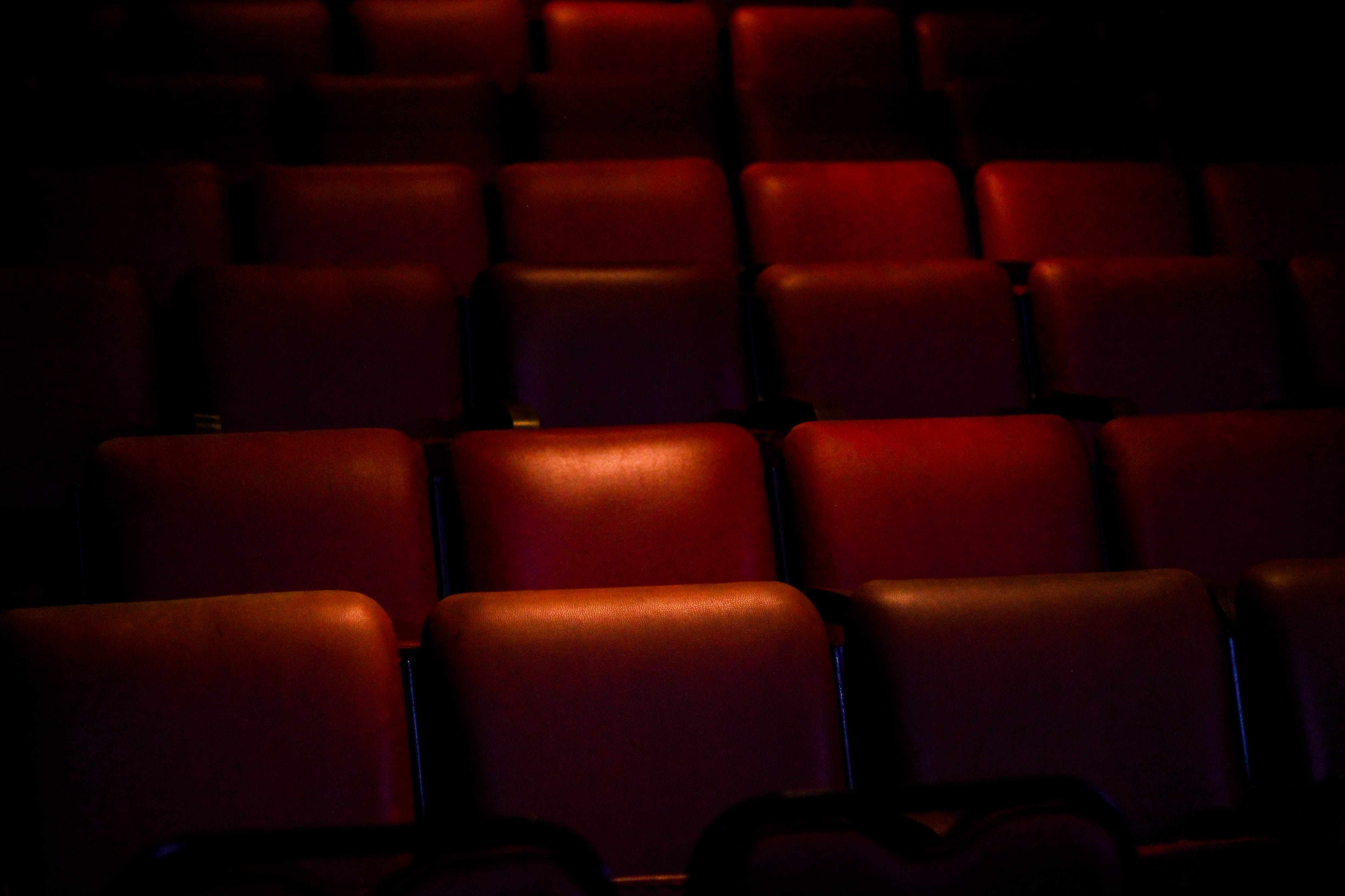 red empty cinema chairs