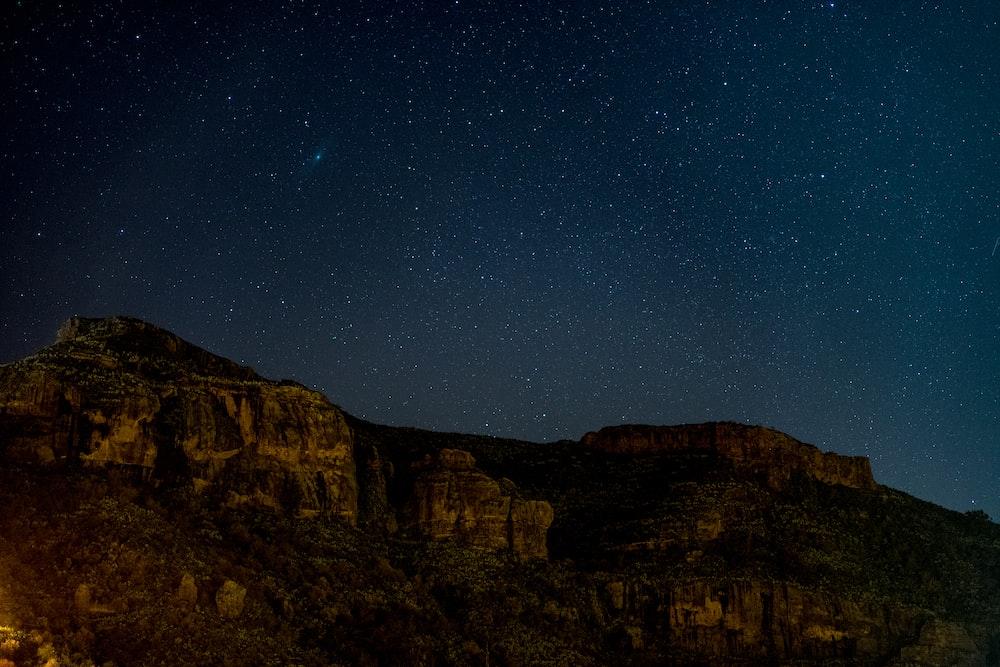rock mountain under starry night