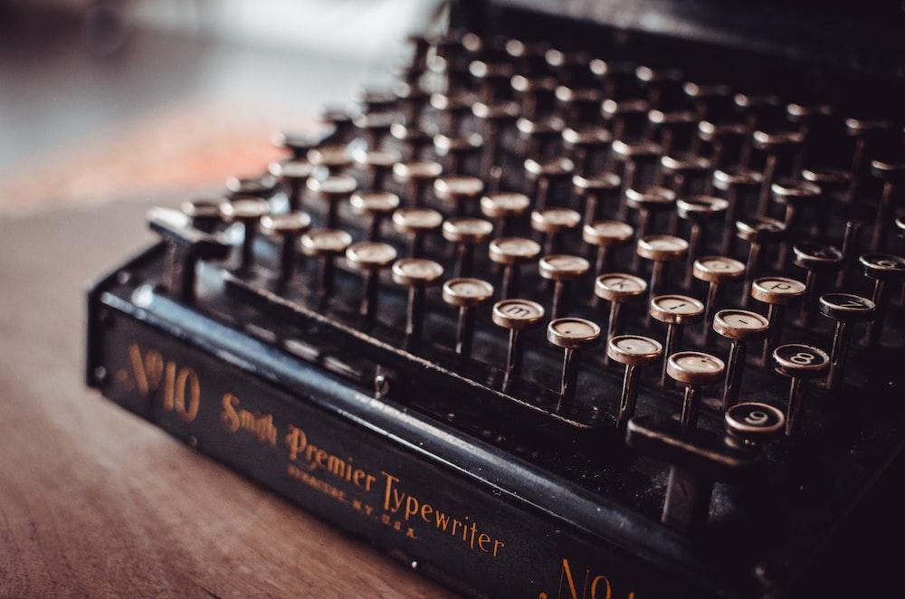 black typewriter on brown panel