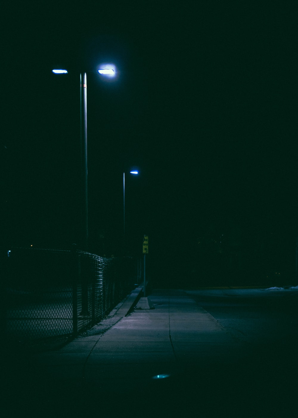 lighted street post at nighttime