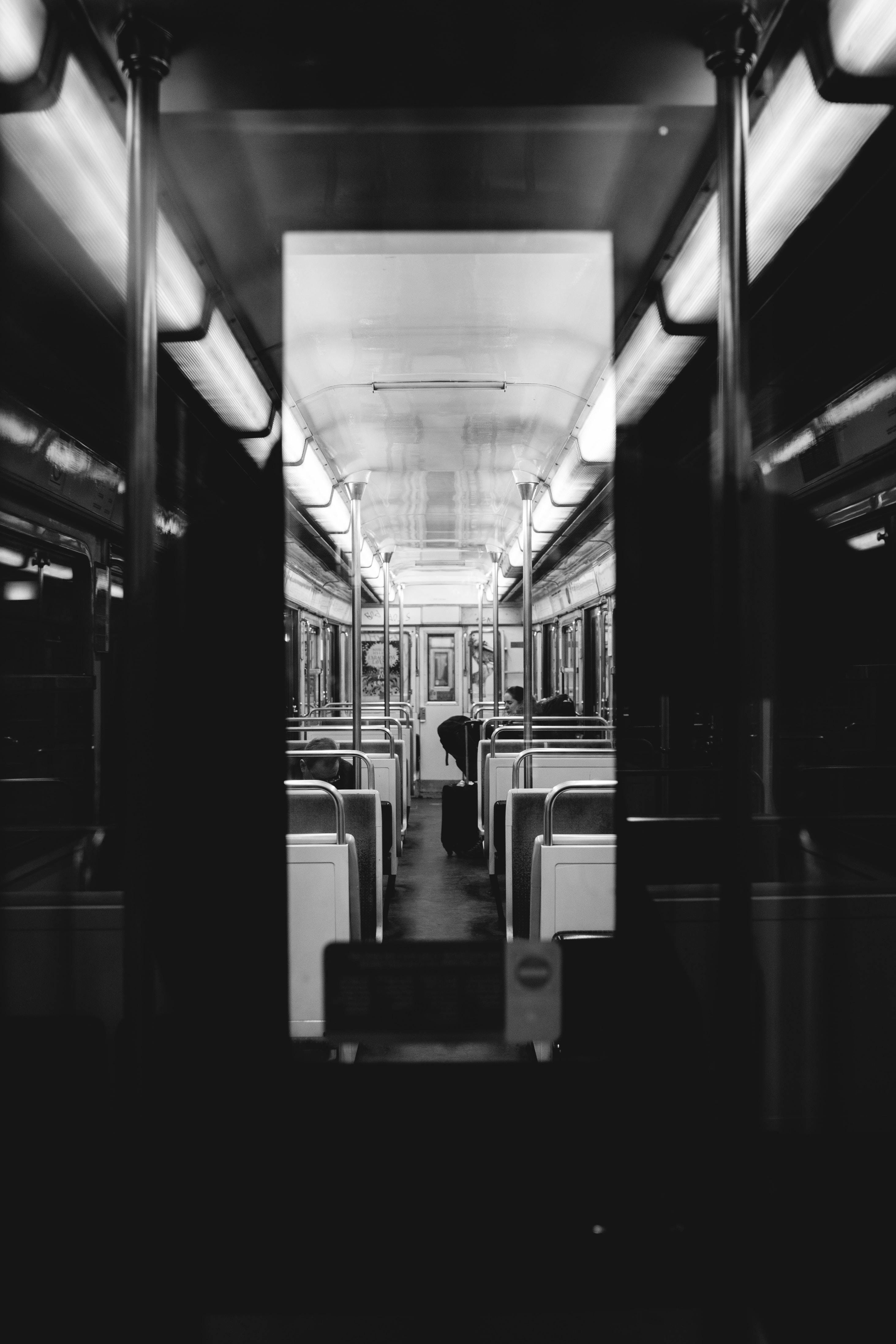 greyscale photo of train interior