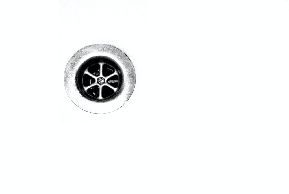 round silver-colored wheel in white background