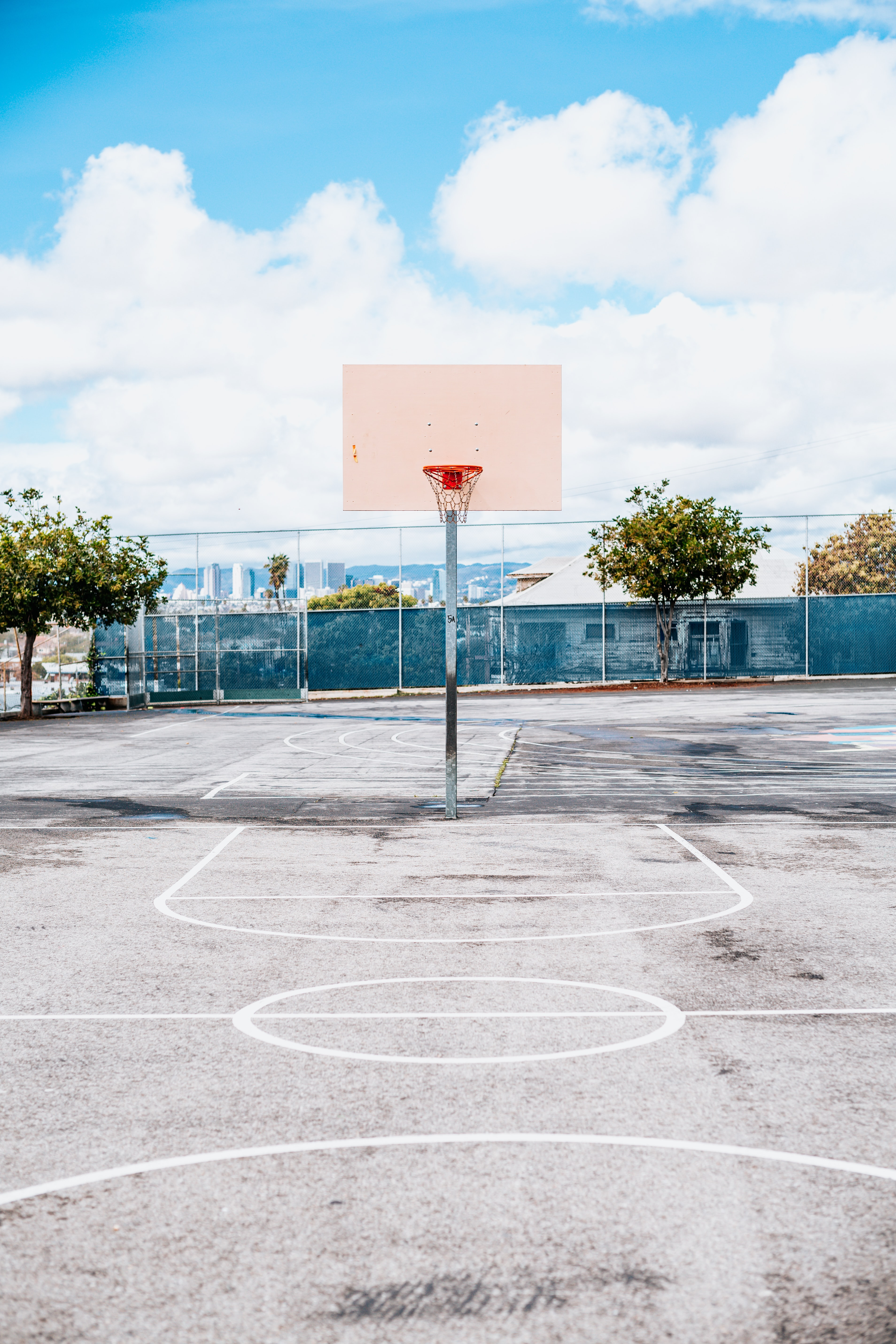 basketball ring under cloudy sky