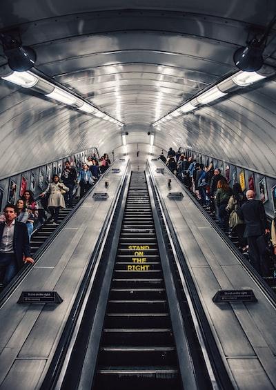 people riding escalator