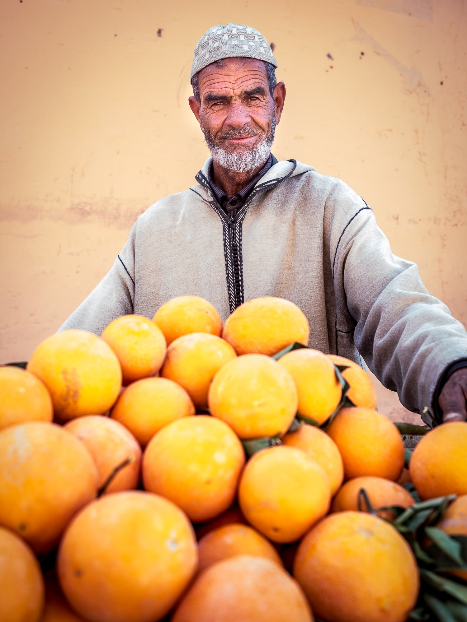 man holding oranges