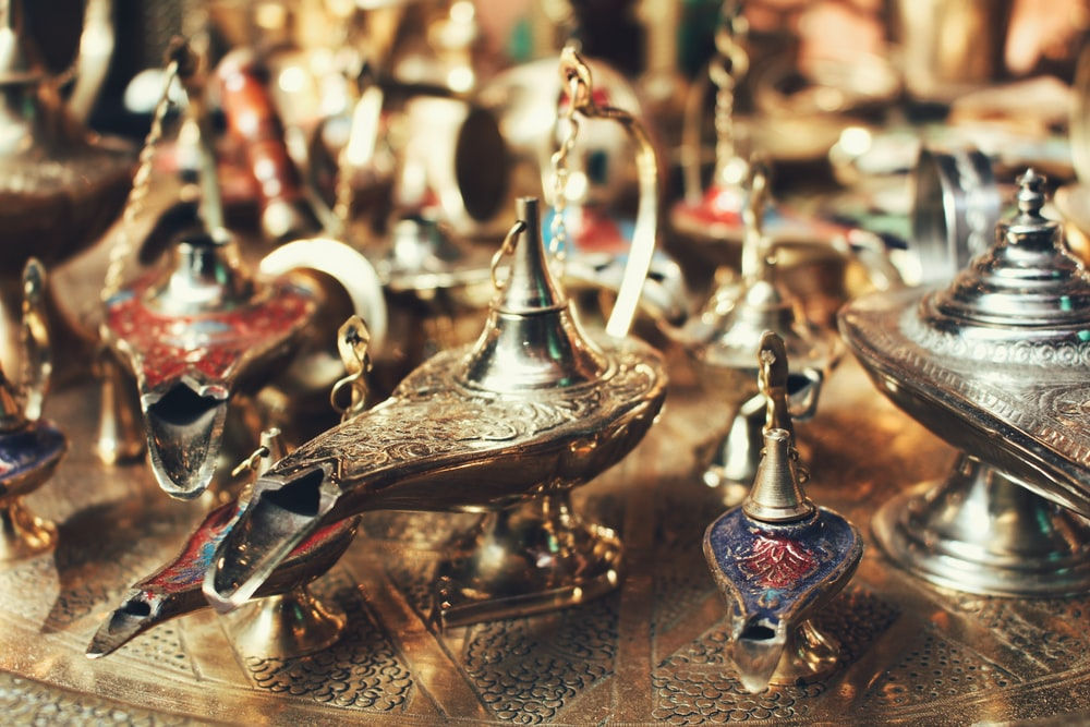 selective focus photo of gold-colored oil lamps