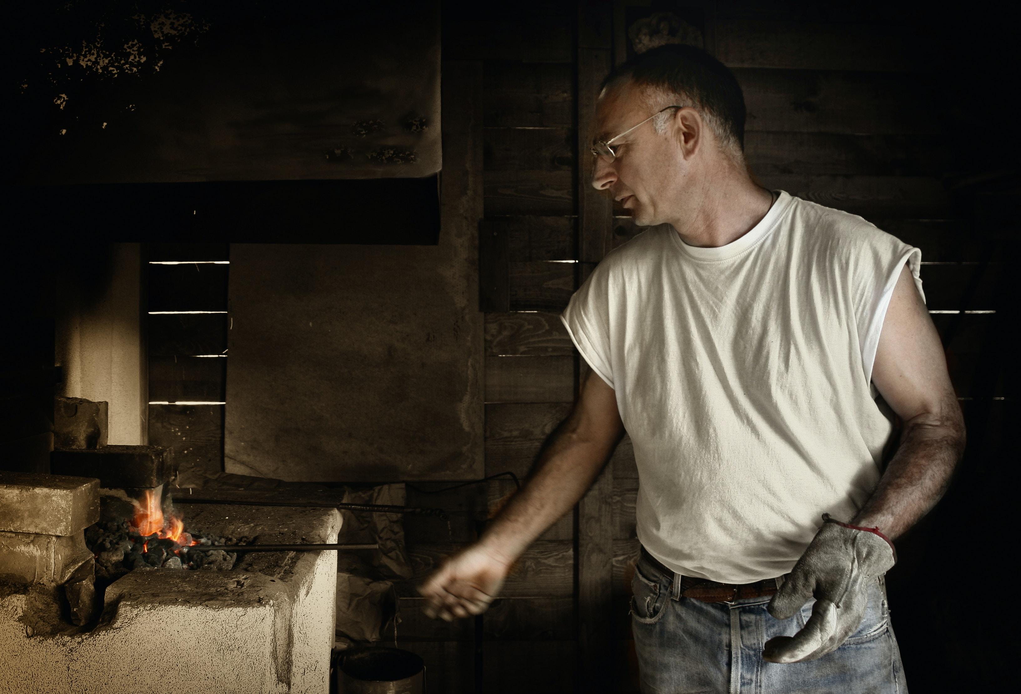 man standing near burner