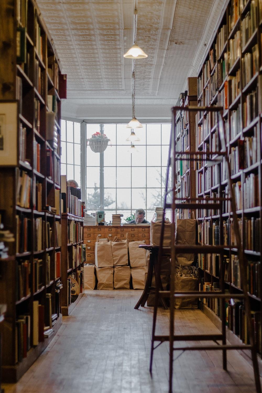 man sitting inside librabry