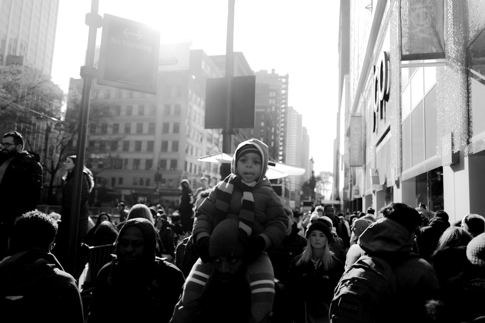 grayscale photography of crowd of people