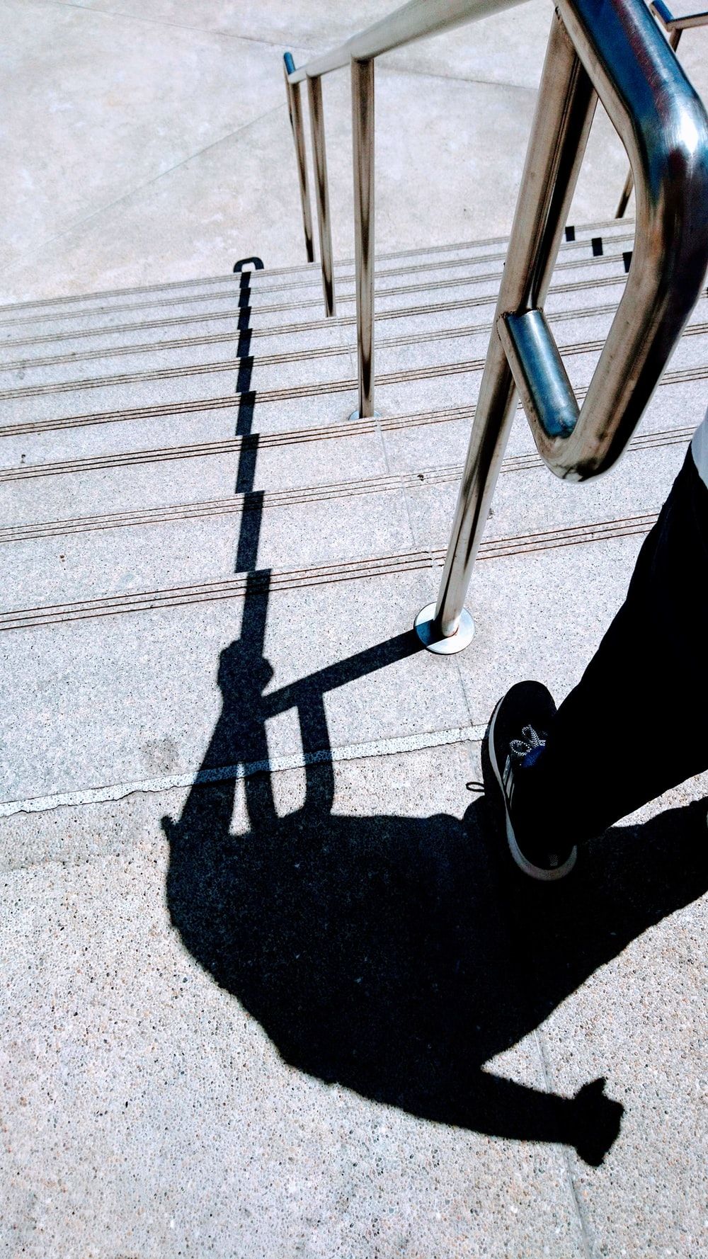 shadow of a person standing on staircase