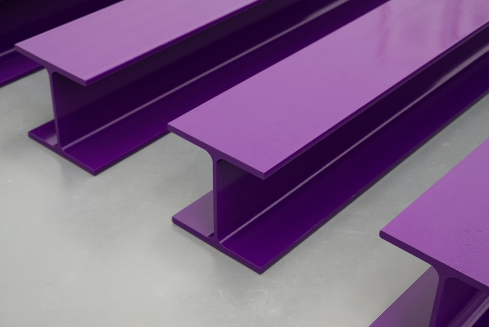 four purple metal frames on white surface
