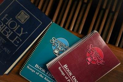 red and blue spiral notebooks on top of brown wooden ta ble