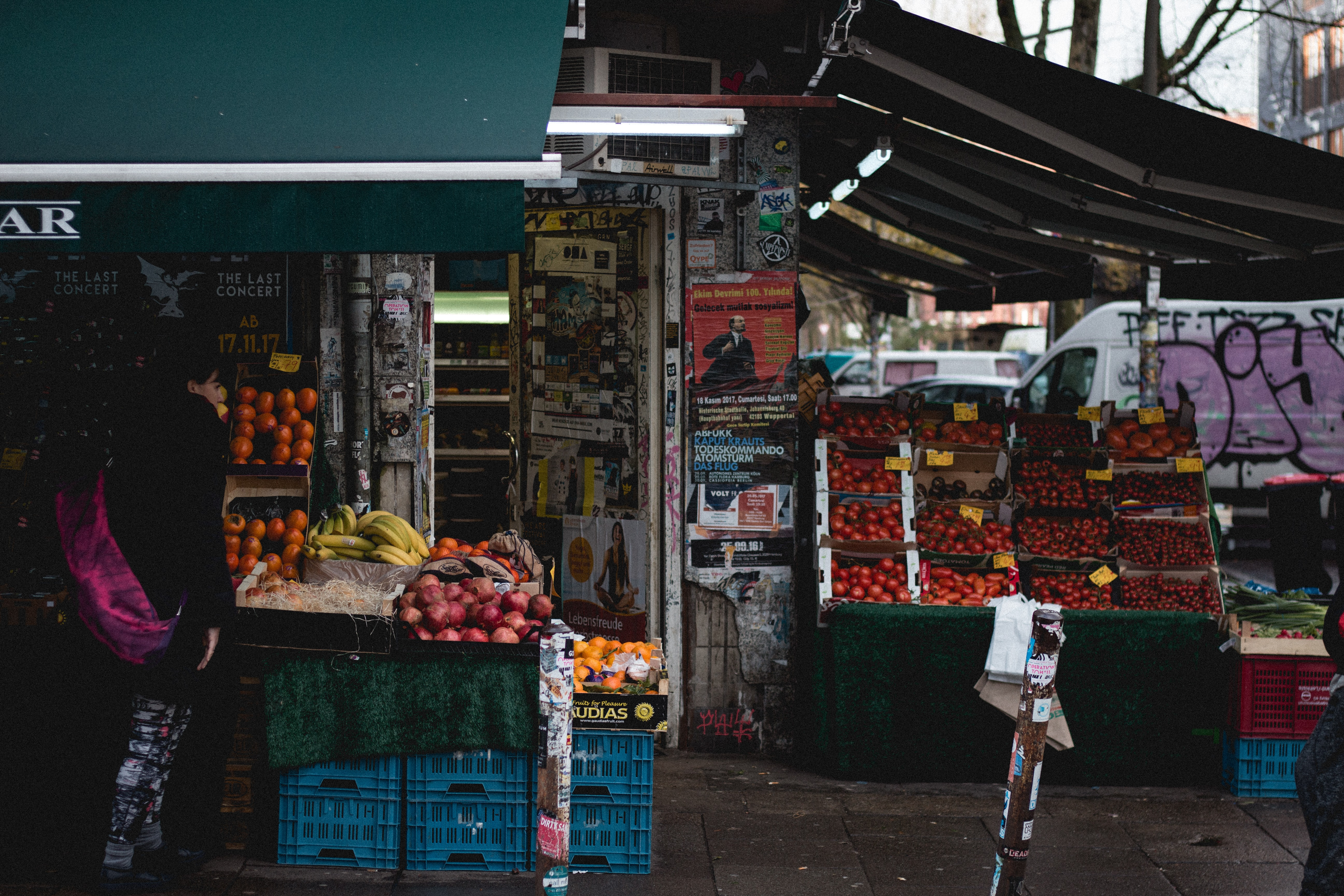 person standing near fruit stand