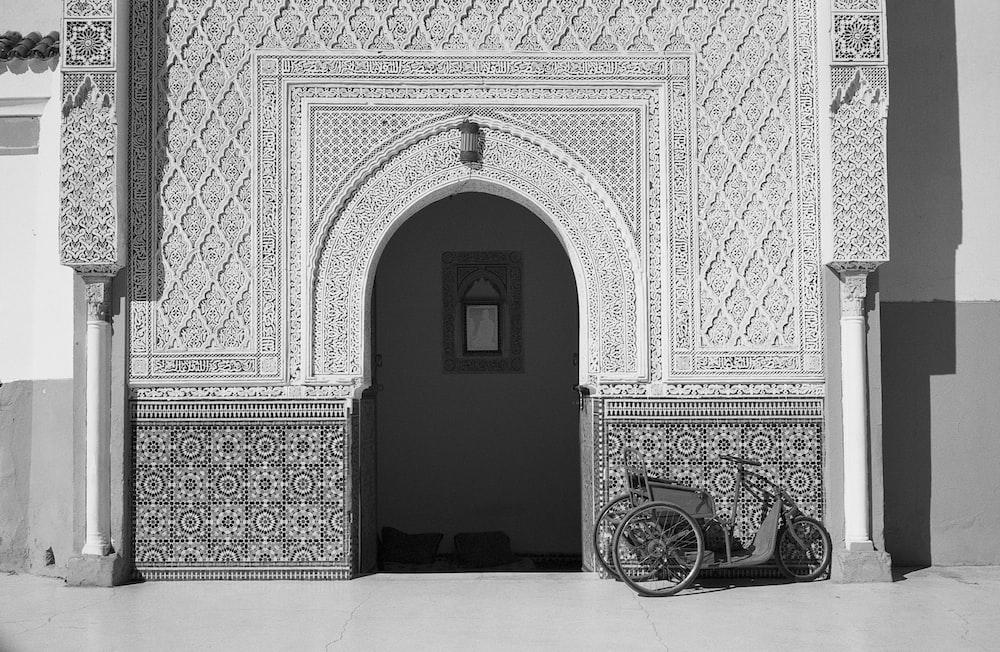 gray trike infront of white concrete house