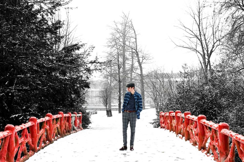 man standing in red bridge