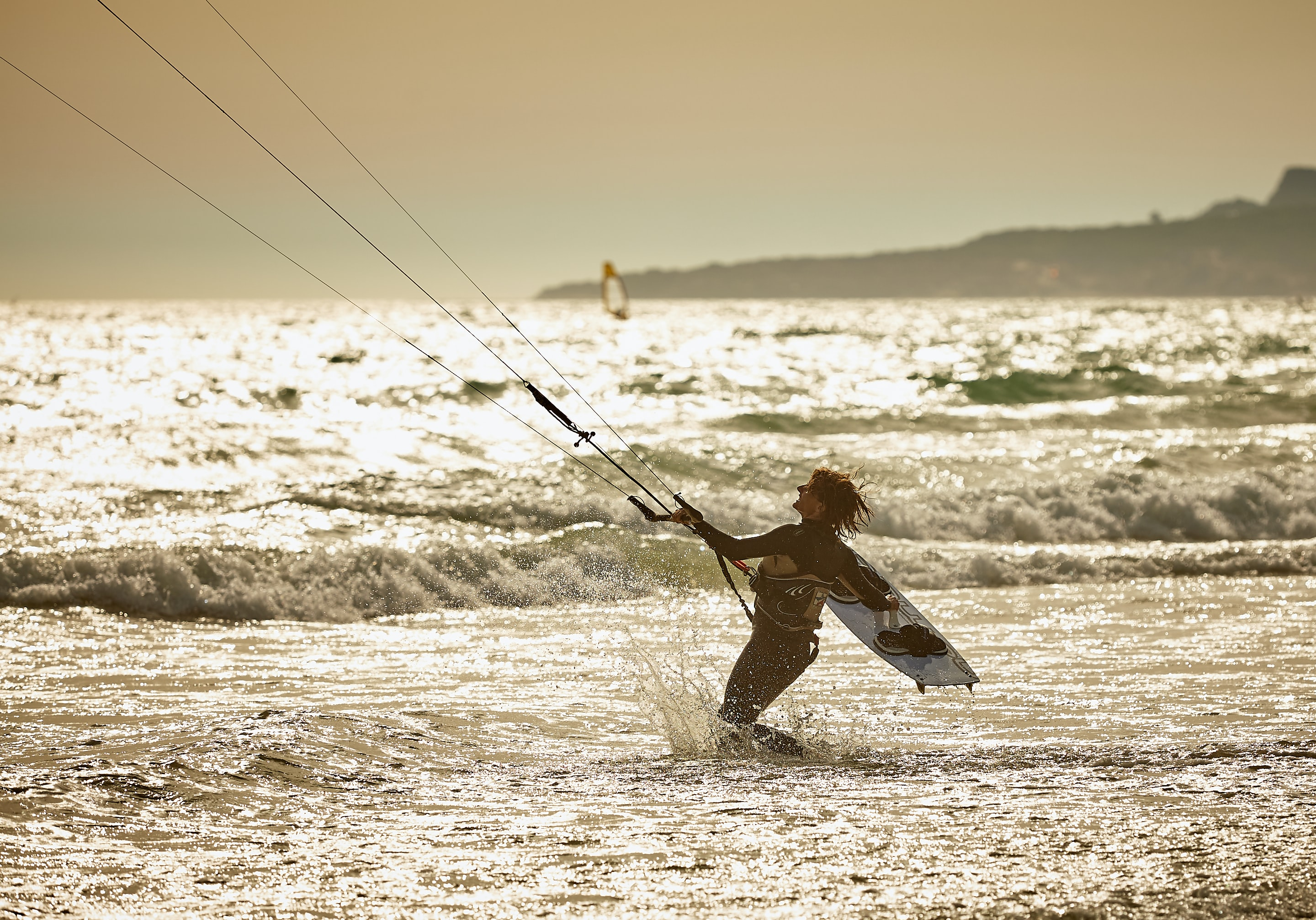 person doing wind surfing on body of water