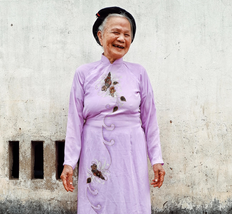 woman standing wearing hat