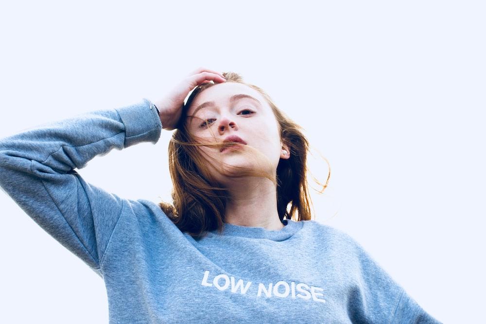 woman wearing blue long-sleeved top