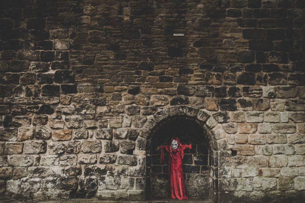 red coat on wall brick
