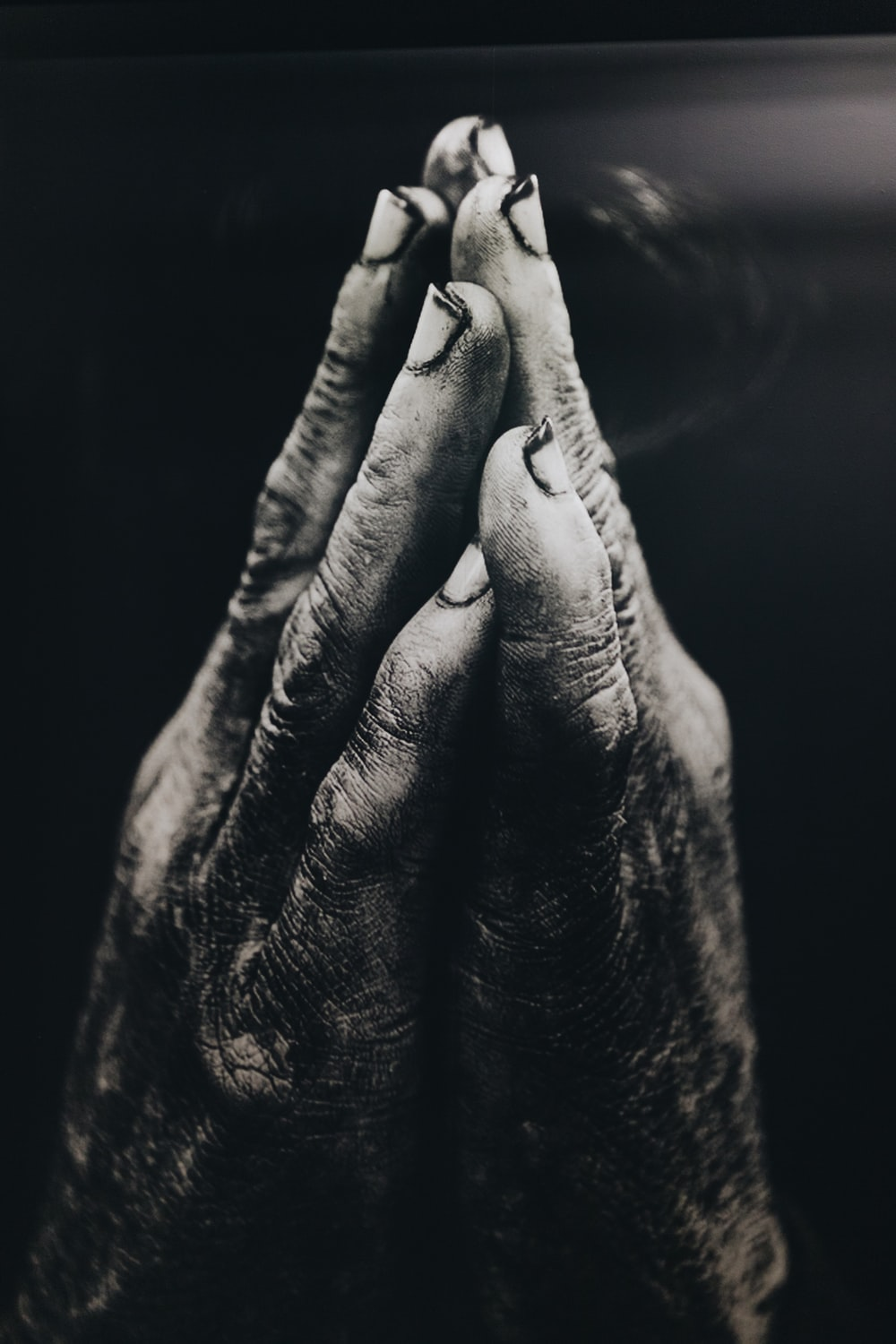 grayscale photography of praying hands