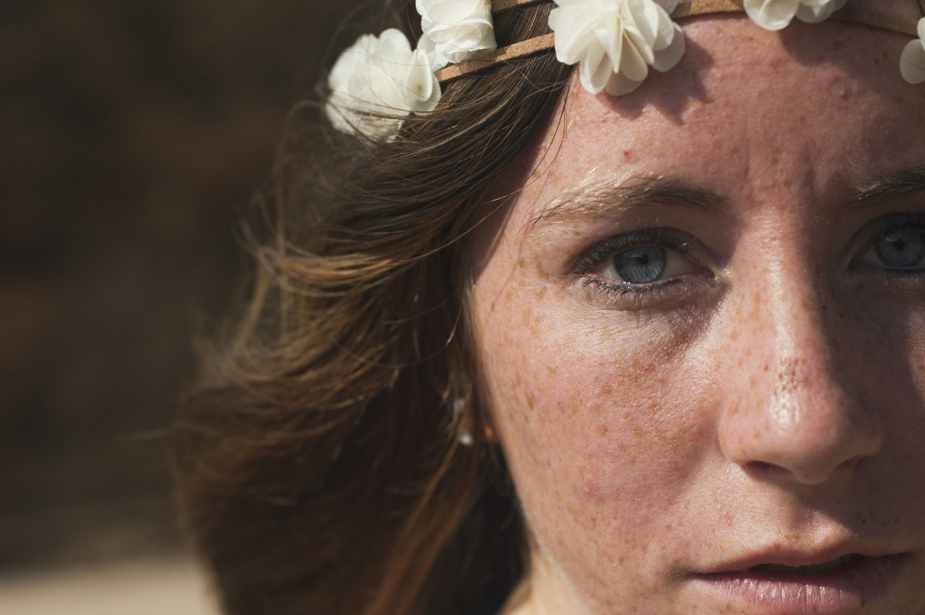 portrait photo of woman wearing floral crown