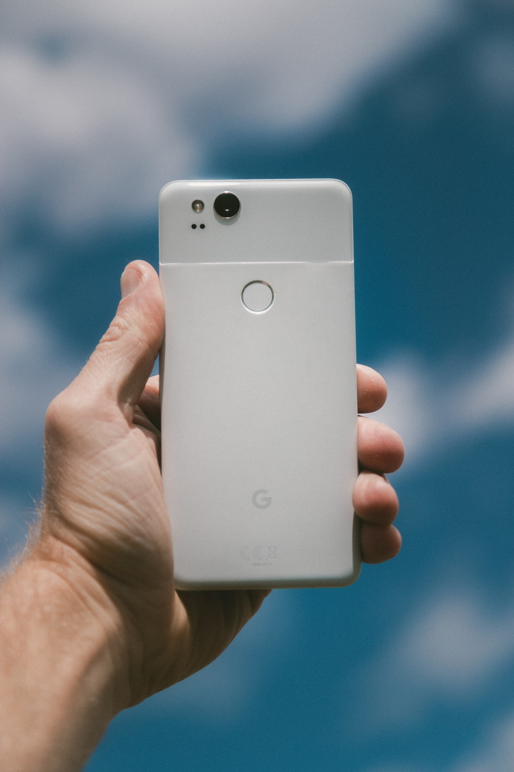 person holding white Google Android smartphone