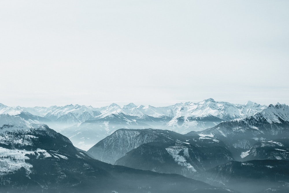 ice covered mountain covered with fog during daytime