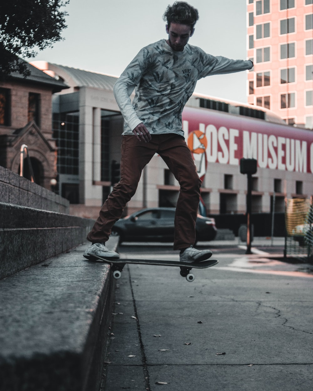 man playing skateboard on staircase