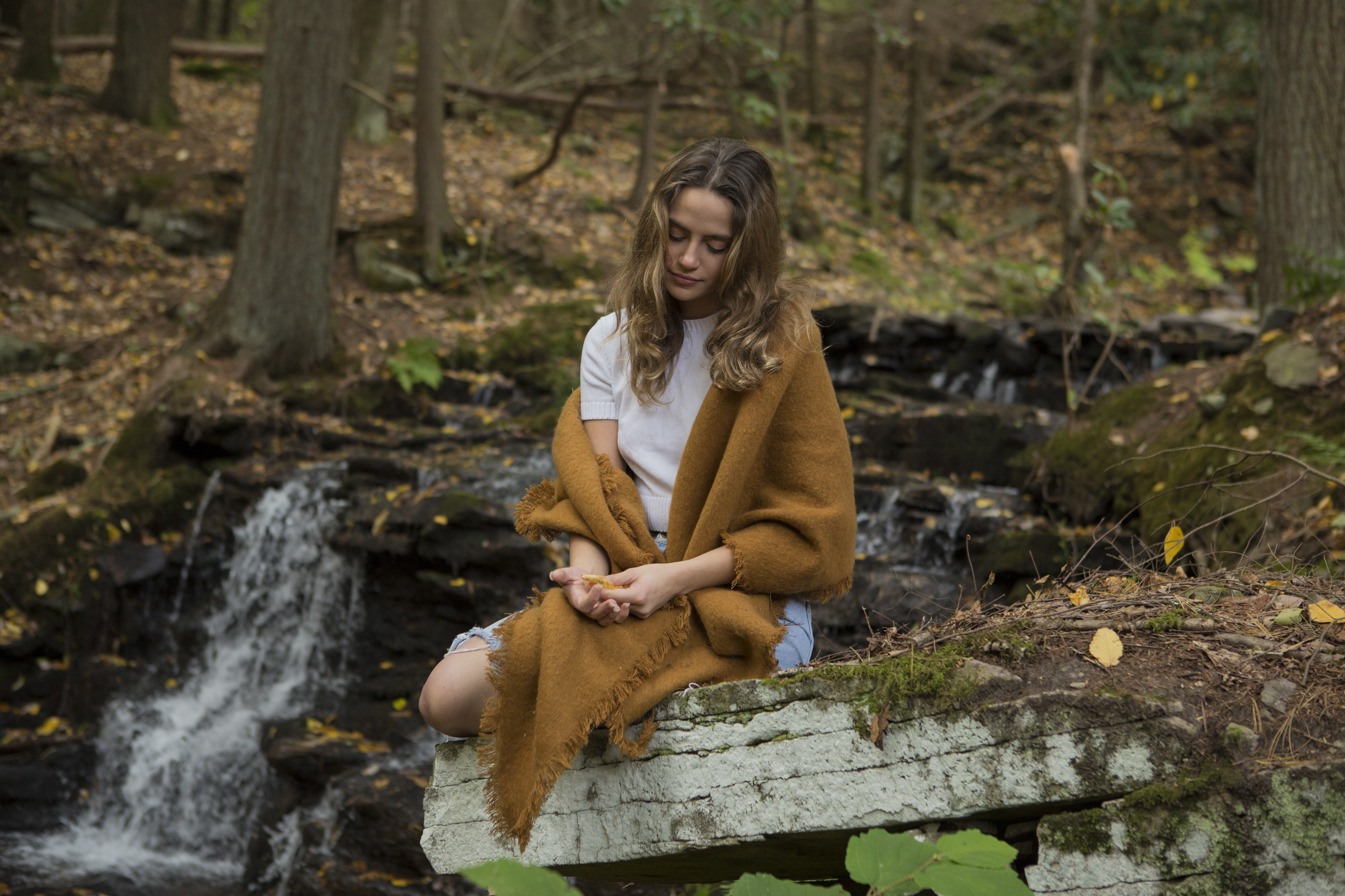 woman meditating on forest