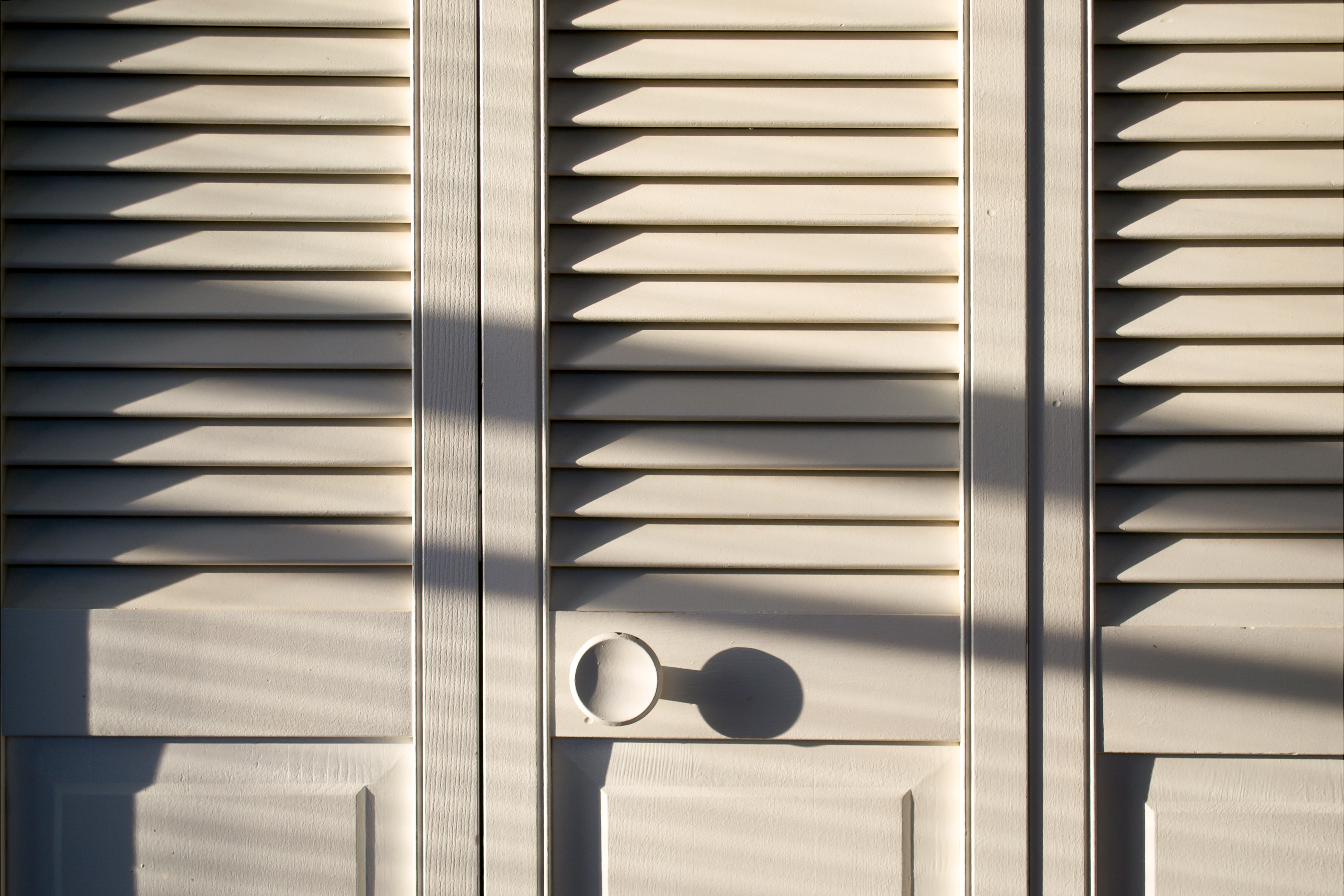 white wooden louver door closed